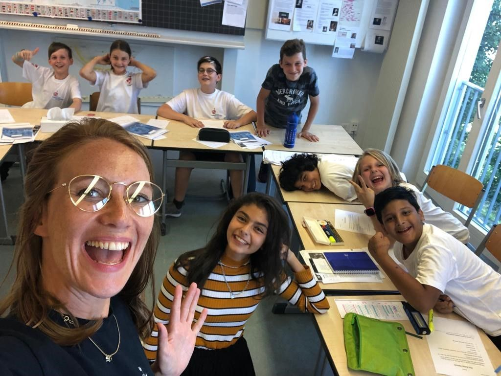 Photo of smiling students in class
