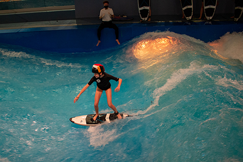girl surfing indoors